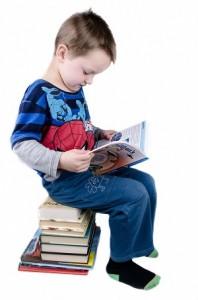 Child Sit on books & reading